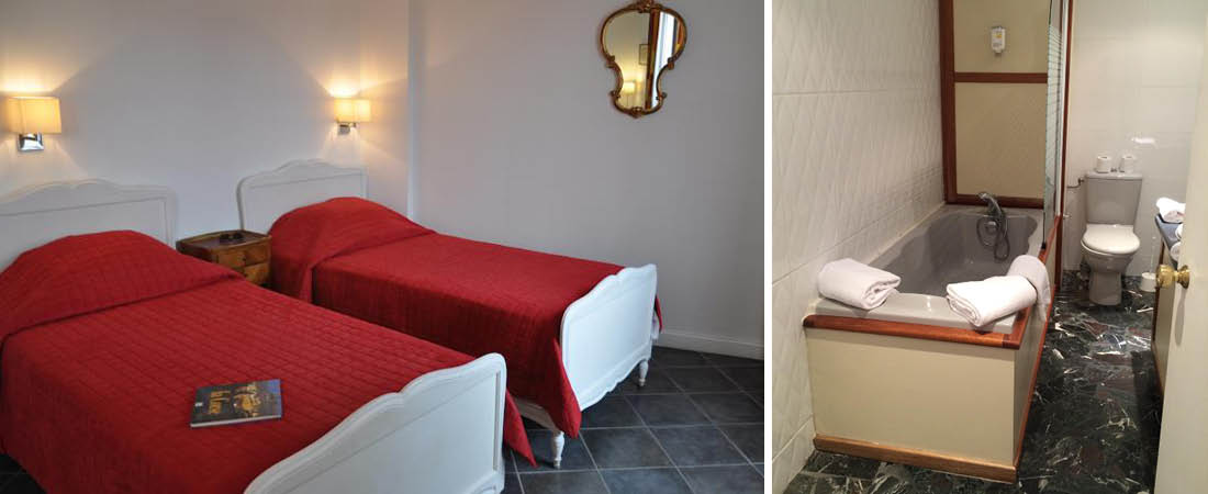 dubbelrum med badrum och badkar med mysig belysning på hotell grand hotel calvi på korsika