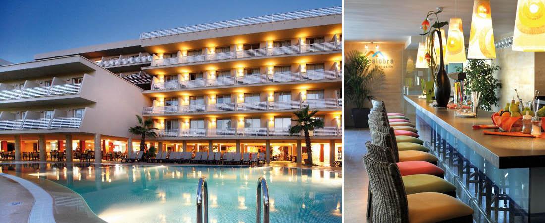 Hotell Barcelo Cala Vinas med poolområde upplyst kvällstid och bardel.