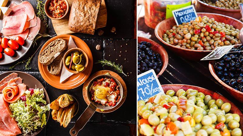spanskt tilltugg som oliver, bröd och korv på rundresa i spanien